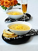 Cheese soup with bread and glass of beer