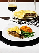 Venison and mushroom pie with pumpkin puree and green beans