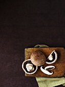 Portobello mushrooms on wooden board (overhead view)