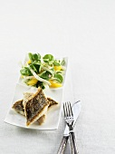 Fried sea bass fillets with side salad