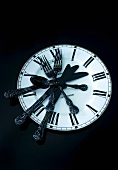 Clock plate with black cutlery
