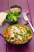 Spaghetti with chick-peas, celery, spinach, tomatoes and Parmesan