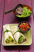 Burritos with bean puree and tomato salsa
