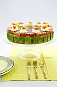 Cake with grape jelly, mint leaves and cream rosettes