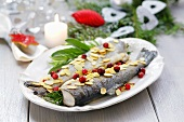 Trout with flaked almonds, herbs and cranberries
