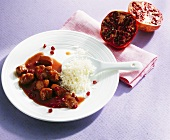 Chicken breast with pomegranate sauce and rice