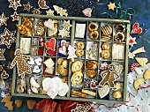 Many different Christmas biscuits in a type case
