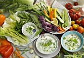 Vegetables with various herb yoghurt dips