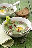 Spinach soup with bacon and boiled egg