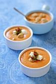 Cream of tomato soup with mozzarella, pesto and dried tomatoes
