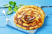 Apple pancakes with icing sugar