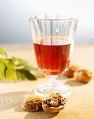 Glass of rosé wine and walnuts