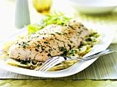Salmon with herbs, potatoes, celeriac and onion