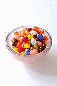 Coloured sugar eggs in a glass dish