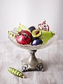 Christmas tree ornaments in shape of fruit & veg in crystal pedestal bowl