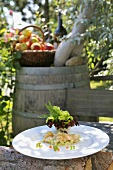 Marinated charr on plate in garden