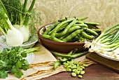 Still life with broad beans, spring onions and fennel