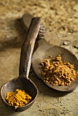 Curry powder on wooden spoons