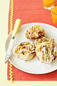 Iced raisin buns with vanilla cream filling