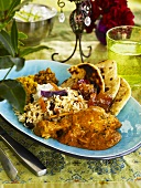 Indian chicken curry with fried rice, lentils, naan bread