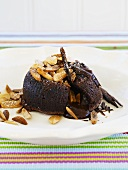 Molten chocolate pudding with toasted almonds