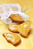 Half-moon-shaped almond biscuits with fabric bag