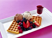 Waffles with ice cream, fresh berries and berry sauce