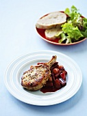 Pork chop with rhubarb chutney, green salad and bread