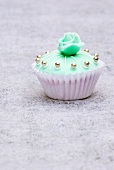 Cupcake (turquoise with silver dragees and marzipan rose)