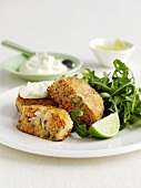 Salmon cakes with rocket and sour cream
