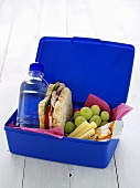 School lunch box (Sandwich, grapes, drink, cheese, muesli bar)