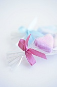 Sugar hearts in cellophane paper with bow