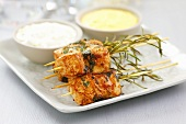 Chicken skewers with rosemary and sauces
