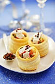 Surimi and smoked salmon vol-au-vents with coloured peppercorns