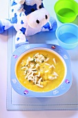 Carrot soup with noodles for children