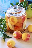 Apricot and pear compote in a glass jar