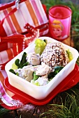 Chicken salad with bread in a plastic box for picnic