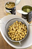 Chick-peas in a sieve and in tins
