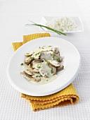 Pork and mushrooms in cream sauce
