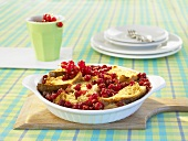 Bread and butter pudding with redcurrants