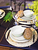 Two place-settings with wholemeal rolls