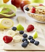 Breakfast ingredients: fruit, berries and cornflakes