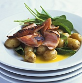 Grilled salmon and new potatoes with melted butter