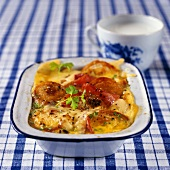 Savoury bread and butter pudding with tomatoes and cheese