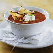 Tomato soup with crème fraîche and grilled bread