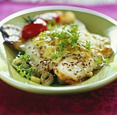 Baked fish fillet with caraway seeds and cress