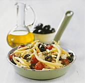 Pasta with black olives, cocktail tomatoes and feta