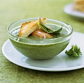 Herb soup with smoked salmon and toast triangle