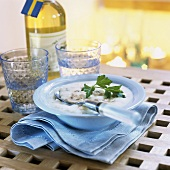 Mushroom soup and bottle of white wine with Swedish flag