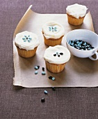 Cupcakes with white icing and sugar decorations